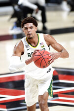Baylor's MaCio Teague (31) passes the ball during the first half of an NCAA college basketball game against Texas Tech in Lubbock, Texas, Saturday, Jan. 16, 2021. (AP Photo/Justin Rex)
