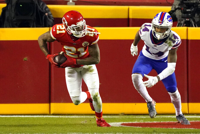 Kansas City Chiefs cornerback Bashaud Breeland (21) runs from Buffalo Bills wide receiver Stefon Diggs (14) after intercepting a 2-point conversion pass during the second half of the AFC championship NFL football game, Sunday, Jan. 24, 2021, in Kansas City, Mo. (AP Photo/Charlie Riedel)