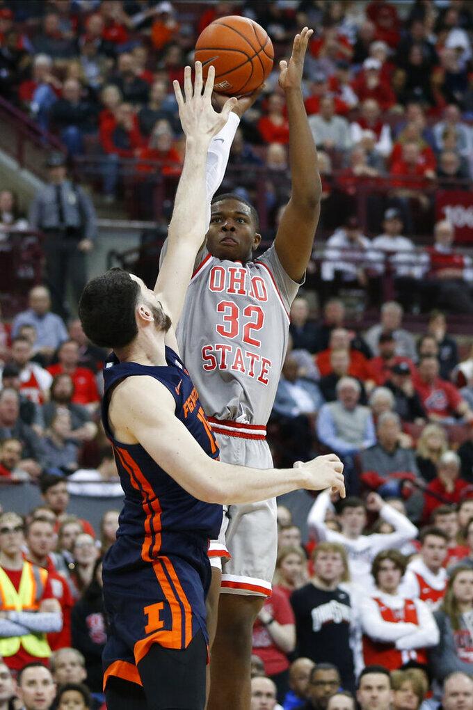 Ohio State's E.J. Liddell shoots over Illinois' Giorgi Bezhanishvili during the second half of an NCAA college basketball game Thursday, March 5, 2020, in Columbus, Ohio. Ohio State won 71-63. (AP Photo/Jay LaPrete)