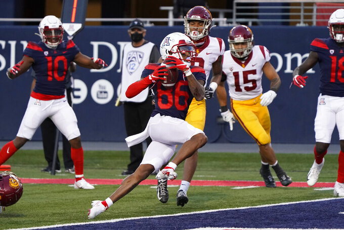 Arizona wide receiver Stanley Berryhill III (86) scores a touchdown against Southern California during the second half of an NCAA college football game Saturday, Nov. 14, 2020, in Tucson, Ariz. Southern California won 34-30. (AP Photo/Rick Scuteri)