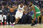 Los Angeles Clippers guard Lou Williams, left, drives past Boston Celtics guard Brad Wanamaker during the second half of an NBA basketball game Wednesday, Nov. 20, 2019, in Los Angeles. (AP Photo/Mark J. Terrill)