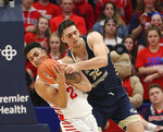 Dayton's Ibi Watson (2) battles George Washington's Javier Langarica (32) for a rebound during the second half of an NCAA college basketball game Saturday, March 7, 2020, in Dayton, Ohio. (AP Photo/Tony Tribble)