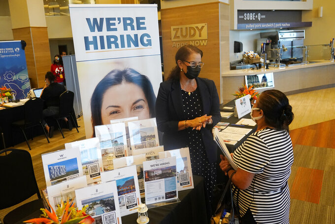 Marriott human resources recruiter Mariela Cuevas, left, talks to Lisbet Oliveros, during a job fair at Hard Rock Stadium, Friday, Sept. 3, 2021, in Miami Gardens, Fla.  The number of Americans seeking unemployment benefits moved up last week to 332,000 from a pandemic low, a sign that worsening COVID-19 infections may have slightly increased layoffs. Applications for jobless aid rose from 312,000 the week before, the Labor Department said Thursday, Sept. 16.  (AP Photo/Marta Lavandier)