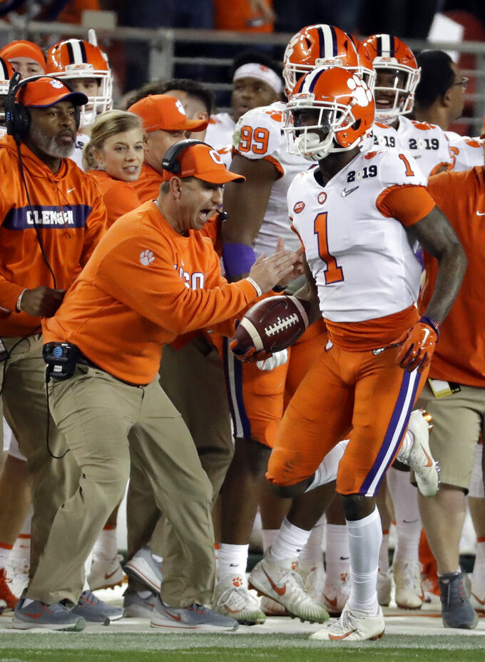 Clemson head coach Dabo Swinney reacts after Trayvon Mullen (1) intercepted a pass during the first half the NCAA college football playoff championship game against Alabama, Monday, Jan. 7, 2019, in Santa Clara, Calif. (AP Photo/Chris Carlson)
