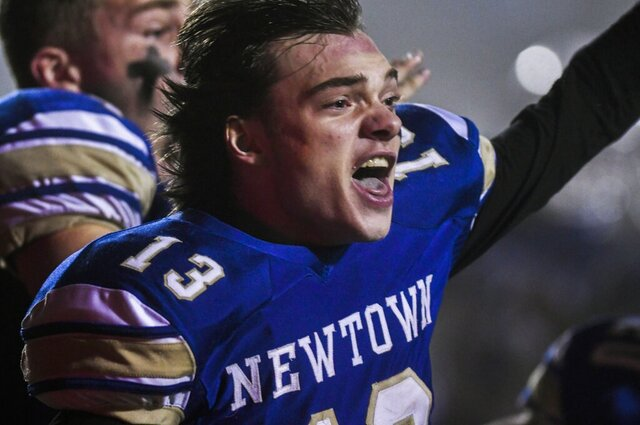 Newtown's Riley Ward (13) reacts and looks back at his teammates after scoring the winning touchdown as the Newtown Nighthawks beat the Darien Blue Wave in the final play of the Class LL state football championship at Trumbull High School Saturday, Dec. 14, 2019, in Trumbull, Conn. Newtown won 13-7. Newtown marked the seventh anniversary of the massacre at Sandy Hook Elementary School with vigils, church services and a moment of joy when the community's high school football team, with a shooting victim's brother as linebacker, won the state championship Saturday in a last-minute thrill. (Kassi Jackson/Hartford Courant via AP)