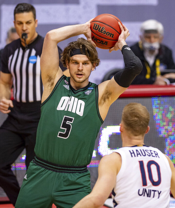 Ohio forward Ben Vander Plas (5) looks for a teammate to pass to during the first half of a first-round game against Virginia in the NCAA men's college basketball tournament, Saturday, March 20, 2021, at Assembly Hall in Bloomington, Ind. (AP Photo/Doug McSchooler)