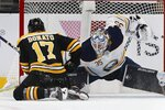 Buffalo Sabres' Linus Ullmark (35) blocks the penalty shot by Boston Bruins' Ryan Donato (17) during the first period of an NHL hockey game in Boston, Sunday, Dec. 16, 2018. (AP Photo/Michael Dwyer)