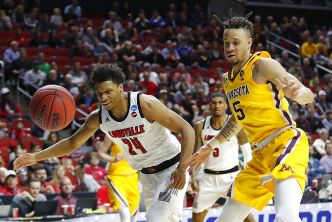 Louisville forward Dwayne Sutton, left, fights for a loose ball with Minnesota guard Amir Coffey during a first round men's college basketball game in the NCAA Tournament, Thursday, March 21, 2019, in Des Moines, Iowa. Minnesota won 86-76. (AP Photo/Charlie Neibergall)
