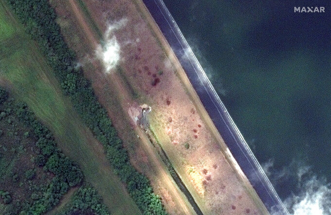 This Monday, April 5, 2021, image provided by Maxar Technologies shows a view of a breach in a retaining pond at the 77-acre Piney Point reservoir in Manatee County, just south of the Tampa Bay area, in Florida.  (Satellite image ©2021 Maxar Technologies via AP)