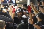 Chicago White Sox's Eloy Jimenez celebrates his grand slam in the dugout off Kansas City Royals starting pitcher Jakob Junis during the first inning of a baseball game Tuesday, Sept. 10, 2019, in Chicago. (AP Photo/Charles Rex Arbogast)