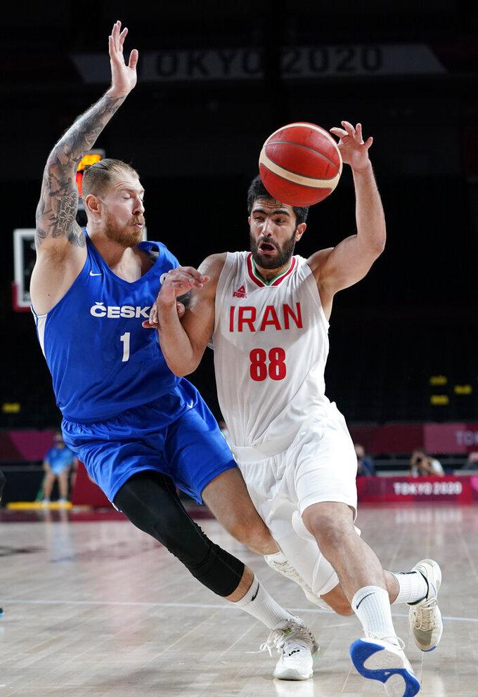 Iran's Behnam Yakhchalidehkordi (88) carries the ball past Czech Republic's Patrik Auda during men's basketball game at the 2020 Summer Olympics, Sunday, July 25, 2021, in Saitama, Japan. (AP Photo/Charlie Neibergall)
