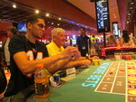 Gamblers play roulette at Bally's casino in Atlantic City N.J., in this June 23, 2021, file photo. Eight of Atlantic City's nine casinos posted an operating profit in the second quarter of this year as business improved and gamblers were eager to return to gambling halls in person. Figures released Monday, Aug. 23, 2021, by the New Jersey Division of Gaming Enforcement show the casinos collectively posted a gross operating profit of $185.1 million in April, May and June of this year.  (AP Photo/Wayne Parry)