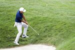 Collin Morikawa chips on the 15th hole during the final round of the Workday Charity Open golf tournament, Sunday, July 12, 2020, in Dublin, Ohio. (AP Photo/Darron Cummings)