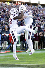 Mississippi State quarterback Tommy Stevens (7) celebrates with tight end Farrod Green (82) after Stevens scored a touchdown on a 3-yard touchdown run against Louisville in the first half of the Music City Bowl NCAA college football game Monday, Dec. 30, 2019, in Nashville, Tenn. (AP Photo/Mark Humphrey)