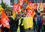 Trade union and Yellow Vests demonstrators gather during a protest in Anglet southwestern France, Saturday Dec.7, 2019. Strikes disrupted weekend travel around France on Saturday as truckers blocked highways and most trains remained at a standstill because of worker anger at President Emmanuel Macron's policies. (AP Photo/Bob Edme)