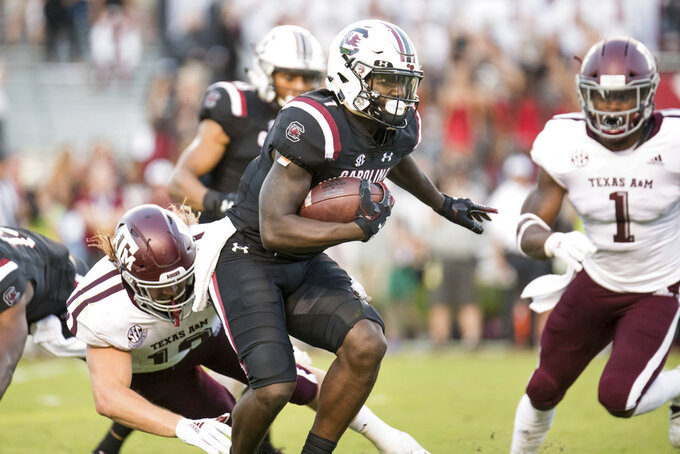 South Carolina wide receiver Deebo Samuel (1) runs with the ball against Texas A&M running back Cullen Gillaspia during the second half of an NCAA college football game Saturday, Oct. 13, 2018, in Columbia, S.C. Texas A&M defeated South Carolina 26-23. (AP Photo/Sean Rayford)
