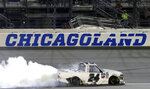 Brett Moffitt does a burnout after winning a NASCAR Truck Series auto race at Chicagoland Speedway in Joliet, Ill., Friday, June 28, 2019. (AP Photo/Nam Y. Huh)
