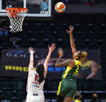 Seattle Storm's Mercedes Russell shoots over Washington Mystics' Megan Gustafson during the first quarter of a WNBA basketball game Tuesday, Sept. 7, 2021, in Everett, Wash. (Dean Rutz/The Seattle Times via AP)