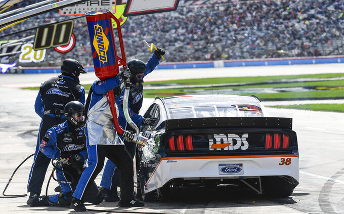Driver David Ragan's pit crew service his car during a NASCAR Cup auto race at Texas Motor Speedway, Sunday, March 31, 2019, in Fort Worth, Texas. (AP Photo/Randy Holt)