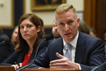 Deputy Assistant Attorney General for National Security Adam Hickey, right, sitting next to Deputy Assistant Director for Counterterrorism at the FBI Nikki Flores, left, testifies before the House Judiciary Committee hearing on Capitol Hill in Washington, Tuesday, Oct. 22, 2019, on election security. (AP Photo/Susan Walsh)