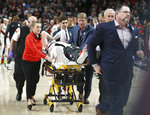 Portland Trail Blazers center Jusuf Nurkic, center, was injured and left the court on a stretcher as the Blazers beat the Brooklyn Nets in double overtime, 148-144, during an NBA basketball game in Portland, Ore., Monday, March 25, 2019. (AP Photo/Randy L. Rasmussen)