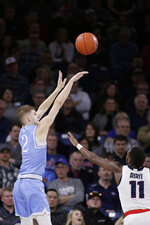 San Diego guard Joey Calcaterra (2) shoots over Gonzaga guard Joel Ayayi (11) during the first half of an NCAA college basketball game in Spokane, Wash., Thursday, Feb. 27, 2020. (AP Photo/Young Kwak)