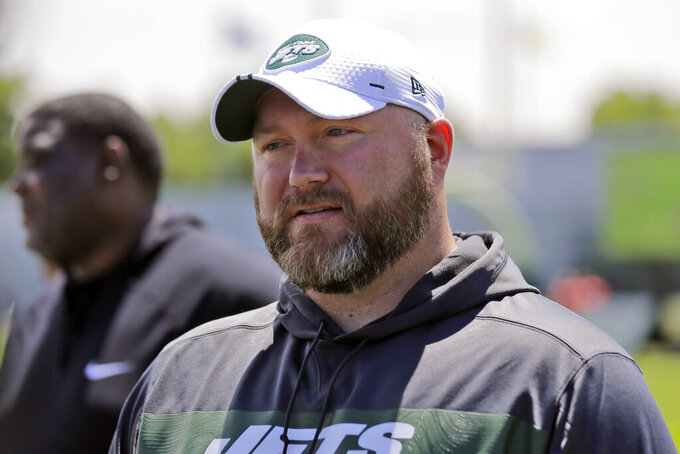 FILE - In this June 11, 2019, file photo, New York Jets general manager Joe Douglas greets reporters during a practice at the team's NFL football training facility in Florham Park, N.J. Douglas is like the rest of the Jets and their fans: He never envisioned such a dreadful start. But here they are, the NFL's only winless team and a loss away from being the first in franchise history to open 0-9. (AP Photo/Seth Wenig, File)