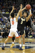 Purdue's Carsen Edwards (3) makes a pass against Virginia's Kihei Clark (0) during the first half of the men's NCAA Tournament college basketball South Regional final game, Saturday, March 30, 2019, in Louisville, Ky. (AP Photo/Timothy D. Easley)