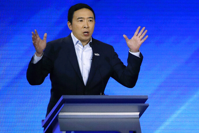 In this Feb. 7, 2020, photo, Democratic presidential candidate entrepreneur Andrew Yang speaks during a Democratic presidential primary debate at Saint Anselm College in Manchester, N.H. (AP Photo/Elise Amendola)