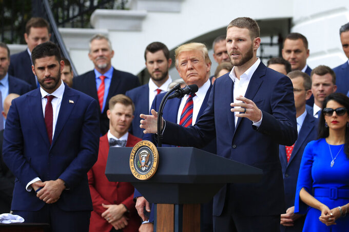Red Sox pitcher Chris Sale, right, speaks during a ceremony welcoming the 2018 World Series baseball champions to the White House, the Boston Red Sox, Thursday, May 9, 2019, in Washington. Watching are President Donald Trump and Red Sox outfielder J. D. Martinez, left. (AP Photo/Manuel Balce Ceneta)