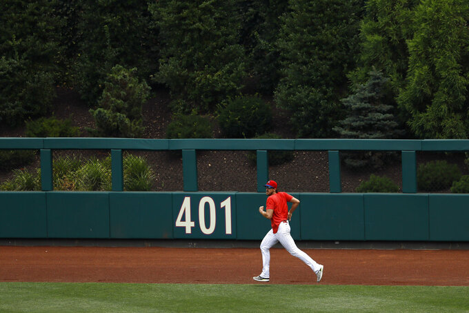 Philadelphia Phillies' Aaron Nola jogs the outfield during baseball practice at Citizens Bank Park, Monday, July 6, 2020, in Philadelphia. (AP Photo/Matt Slocum)