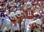 Texas quarterback Sam Ehlinger (11) directs his team against Oklahoma during the first half of an NCAA college football game at the Cotton Bowl, Saturday, Oct. 12, 2019, in Dallas. (Nick Wagner/Austin American-Statesman via AP)