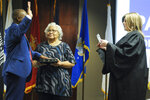 """Betty Paschal looks on as her son retired Army Sgt. Kenneth Paschal is sworn in by Judge Lara Alvis as the first Black Republican elected to the Alabama Legislature since Reconstruction on Wednesday, July 14, 2021, in Pelham, Ala. Paschal said his victory in a heavily white, suburban district shows that the GOP """"is open to everyone."""" (AP Photo/Jay Reeves)"""