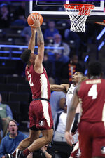 Florida State Anthony Polite (2) dunks in the first half against Wake Forest during an NCAA college basketball game Wednesday, Jan. 8, 2020 in Winston-Salem, N.C. (AP Photo/Lynn Hey)