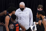Oregon State head coach Wayne Tinkle, center, talks to his players during a timeout in the first half of an Elite 8 game against Houston in the NCAA men's college basketball tournament at Lucas Oil Stadium, Monday, March 29, 2021, in Indianapolis. (AP Photo/Darron Cummings)