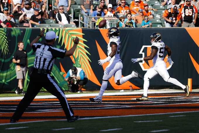Jacksonville Jaguars defensive end Yannick Ngakoue (91) runs in an interception for a touchdown in the second half of an NFL football game against the Cincinnati Bengals, Sunday, Oct. 20, 2019, in Cincinnati. (AP Photo/Frank Victores)