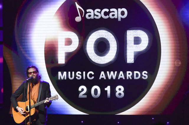 FILE - This April 23, 2018 file photo shows Josh Tillman performing at the 2018 ASCAP Pop Music Awards in Beverly Hills, Calif. The performing rights organization announced Thursday, May 28, 2020 that it will hold three-day virtual events for its four awards shows, which focus on pop, R&B, Latin and film music. The ASCAP Pop Music Awards will be held June 17-19; the ASCAP Screen Music Awards on June 23-25; the ASCAP Latin Music Awards on July 7-9; and the ASCAP Rhythm & Soul Music Awards on July 15-17. (Photo by Richard Shotwell/Invision/AP, File)