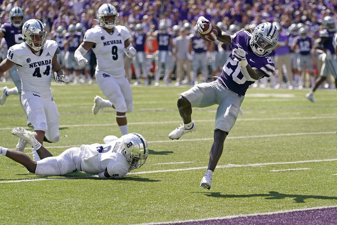 Kansas State running back Joe Ervin (20) runs into the end zone to score a touchdown during the first half of an NCAA college football game against Nevada Saturday, Sept. 18, 2021, in Manhattan, Kan. (AP Photo/Charlie Riedel)