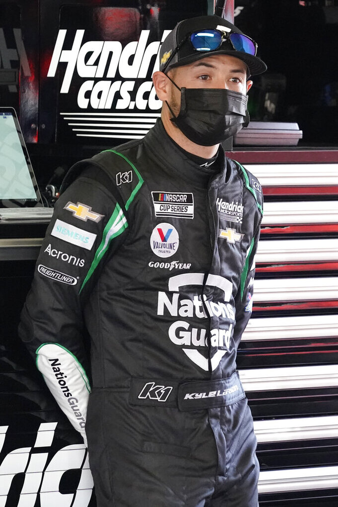 Kyle Larson stands in his garage during a NASCAR Daytona 500 auto race practice session at Daytona International Speedway, Wednesday, Feb. 10, 2021, in Daytona Beach, Fla. (AP Photo/John Raoux)