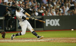 New York Yankees' DJ LeMahieu hits an RBI single against the Boston Red Sox during the fifth inning of a baseball game, Saturday, June 29, 2019, in London. Major League Baseball made its European debut game Saturday at London Stadium. (AP Photo/Tim Ireland)