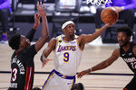 Los Angeles Lakers' Rajon Rondo (9) goes up for a shot against Miami Heat's Bam Adebayo (13) during the first half in Game 6 of basketball's NBA Finals Sunday, Oct. 11, 2020, in Lake Buena Vista, Fla. (AP Photo/Mark J. Terrill)