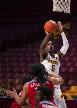 Minnesota guard Marcus Carr (5) shoots against Loyola Marymount in the first half of an NCAA college basketball game Monday, Nov. 30, 2020, in Minneapolis. (Jeff Wheeler/Star Tribune via AP)