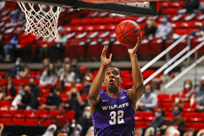 Abilene Christian's Joe Pleasant (32) lays up the ball during the second half of the team's NCAA college basketball game against Texas Tech, Wednesday, Dec. 9, 2020, in Lubbock, Texas. (AP Photo/Brad Tollefson)