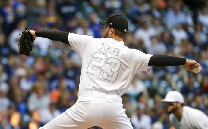 Milwaukee Brewers starting pitcher Jordan Lyles throws during the first inning of a baseball game against the Arizona Diamondbacks Friday, Aug. 23, 2019, in Milwaukee. (AP Photo/Morry Gash)