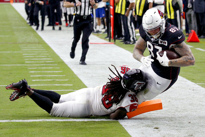 Arizona Cardinals tight end Maxx Williams (87) scores a touchdown as Atlanta Falcons defensive back Kemal Ishmael (36) defends during the second half of an NFL football game, Sunday, Oct. 13, 2019, in Glendale, Ariz. (AP Photo/Ross D. Franklin)