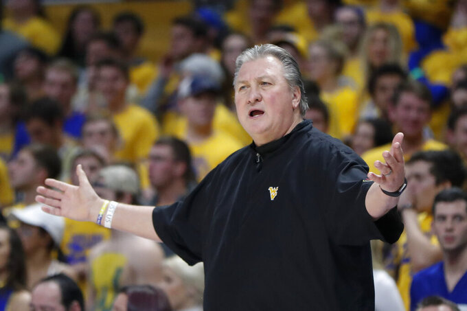 West Virginia head coach Bob Huggins complains to officials as his team plays against Pittsburgh during the first half of an NCAA college basketball game, Friday, Nov. 15, 2019, in Pittsburgh. (AP Photo/Keith Srakocic)