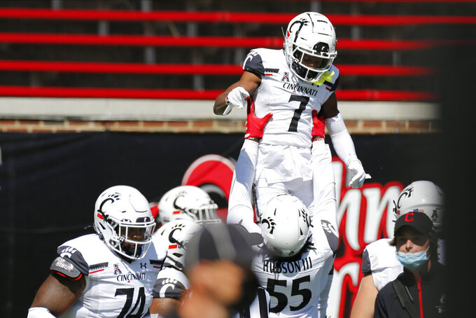 Cincinnati wide receiver Tre Tucker (7) celebrates with teammates after a touchdown against Austin Peay during the first half of an NCAA college football game Saturday, Sept. 19, 2020, in Cincinnati, Ohio. (AP Photo/Jay LaPrete)