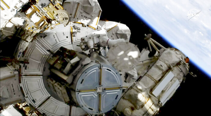 This image provided by NASA shows astronauts Andrew Morgan on a spacewalk outside the International Space Station on Friday, Oct. 11, 2019.   Morgan and Christina Koch are replacing decade-old batteries in the station's solar power network with new and improved lithium-ion versions.  It's the second of five spacewalks planned this month to install six new batteries that arrived via a Japanese supply ship two weeks ago  (NASA via AP)
