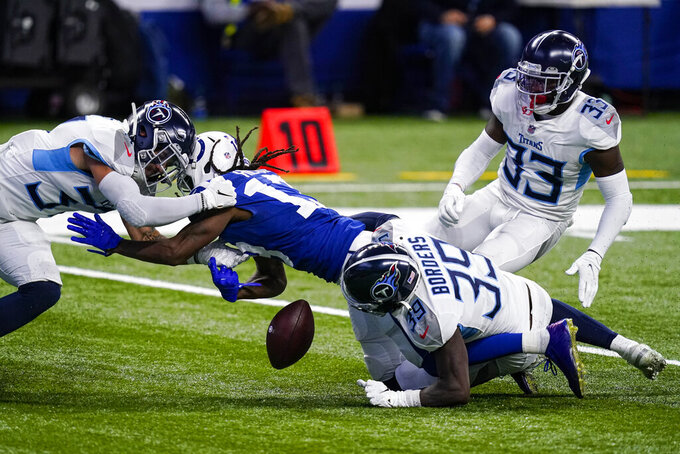 Indianapolis Colts wide receiver T.Y. Hilton (13) fumbles as he's tackled by Tennessee Titans defensive back Chris Jackson (35) in the second half of an NFL football game in Indianapolis, Sunday, Nov. 29, 2020. Hilton was ruled down on the play. (AP Photo/Darron Cummings)