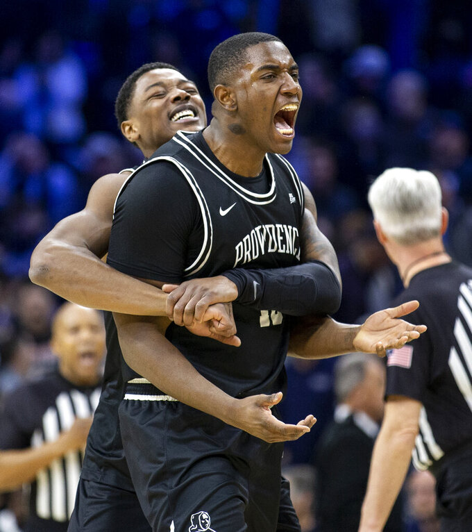 Providence forward Kalif Young (13), right, and Providence forward Emmitt Holt (15) celebrate their 58-54 win over Villanova after an NCAA college basketball game, Saturday, Feb. 29, 2020, in Philadelphia, Pa. (AP Photo/Laurence Kesterson)